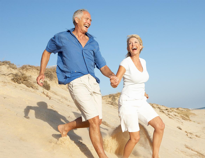senior-couple-enjoying-beach-holiday